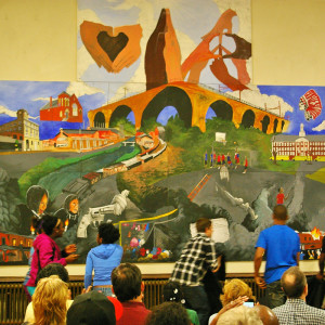 Bridge Academy students show off their mural at June's unveiling. The mural was recognized Thursday night as a piece that has had a positive effect on the community.