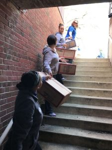 An assembly line was formed from the back alley of the West Chester Y to the basement to deliver 1,482 coats to be distributed to children in need.