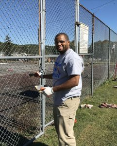 Coatesville resident Courtney Allen volunteered his time by painting the fence around the tennis courts at the park.