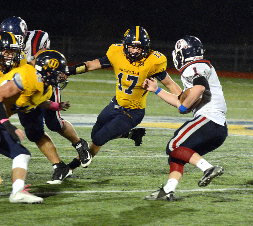Unionville's Jesse Gill closes in on Octorara's Damien Fahy. Gill and his fellow linebackers James Watson and Trevor Gardiner powered a strong Indians' defense, Friday night. Alex Castina photo.