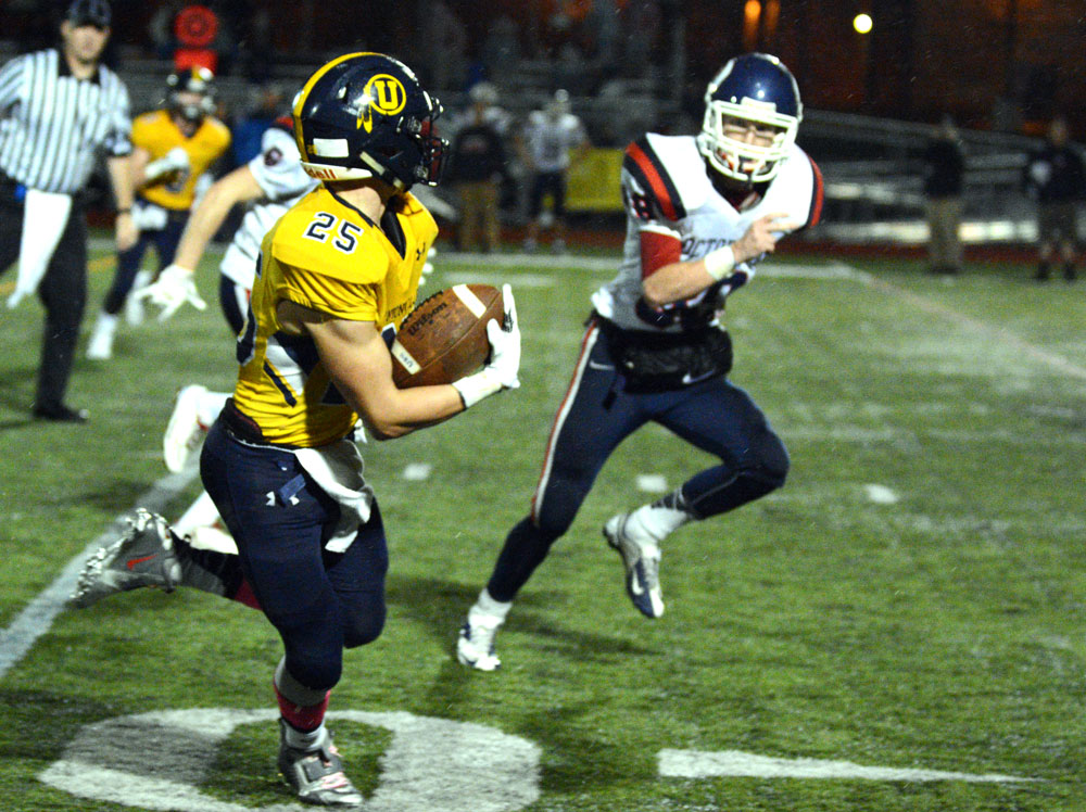 Unionville's Jack Adams races up the right sideline. Adams scored a pair of TDs in the Indians' 25-7 win, Friday night. Alex Castina photo.