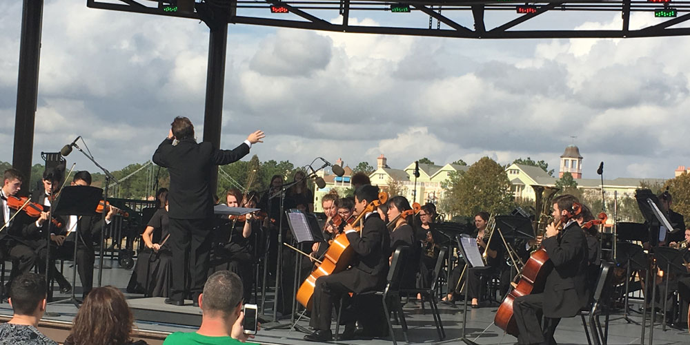 The Unionville High School Orchestra performs at Disney Springs, Thursday.