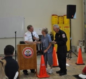 Ron Miller, president of the Chester County Fire Police Association, congratulates Louise and Bob Massey, the Fire Police Officers of the Year for 2012.