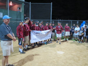 Members of the KAU team – the U.S. Senior League Baseball champs – line up for an appreciative crowd at their field on Leslie Road in Kennett Square.