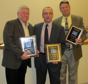 New Garden Township awards plaques of appreciation to three outgoing supervisors: Robert Perrotti (from left), Peter Scilla, and Bob Norris.