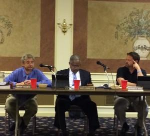 Kennett Square Borough Manager Brant Kucera (from left) discusses finances as Borough Council President Leon R. Spencer Jr. and Mayor Matt Fetick listen.