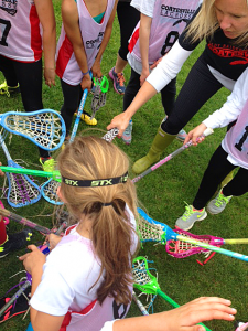 The 3-4 team of girls, led by coaches Melissa O'Hara and Heidi Williams put all of their sticks in to cheer on their team for a great game. Credit Coatesville Youth Lacrosse