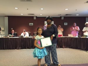 City council president Linda Lavender- Norris presented Ollis with an award in recognition of her efforts to beautify the city.