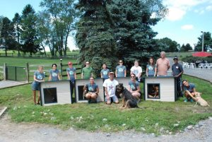 After completing the doghouses, employees from Evolve IP showed off their handy work to the rescue dogs on the property.