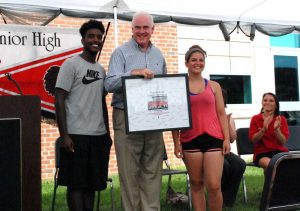 Kameron Reeves and Sarah Morroney, drum majors for the marching band, presented Meehan with a framed picture, signed by all band members.