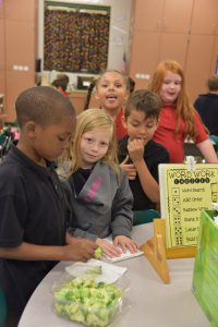 Students at Caln Elementary School sample fresh vegetables and fruits as part of a new program at the school.