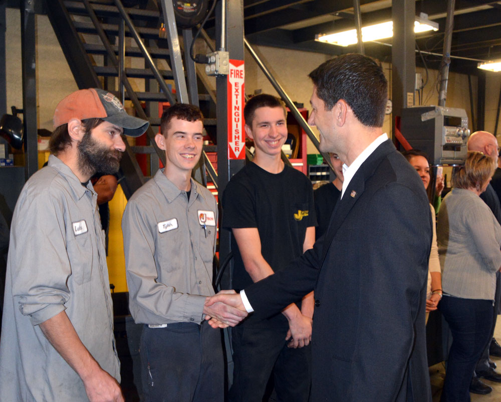 Paul Ryan speaks with J-Tech employees following an event with U.S. Rep. Ryan Costello, Thursday.
