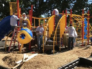 Over 200 volunteers gathered at Patton Park in Coatesville Friday morning to assemble a new playground that was designed by children in August.