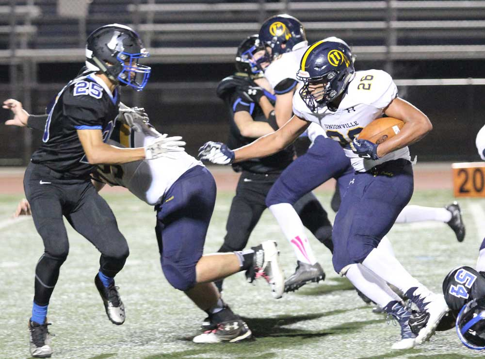 Unionville's Dante Graham rips off a run against Kennett. Graham's strong second half helped power a dominating second Indian run game. Jim Gill photo.