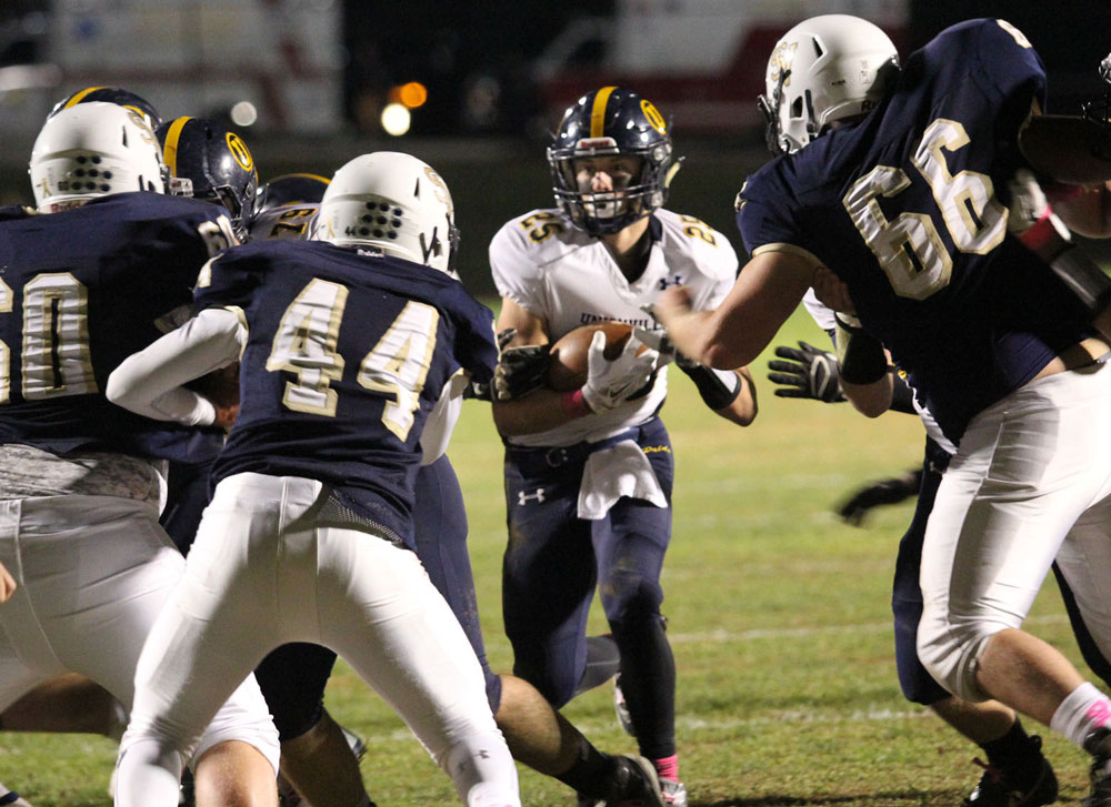 Unionville's Jack Adams fights for yards against Sun Valley. Jim Gill photo.