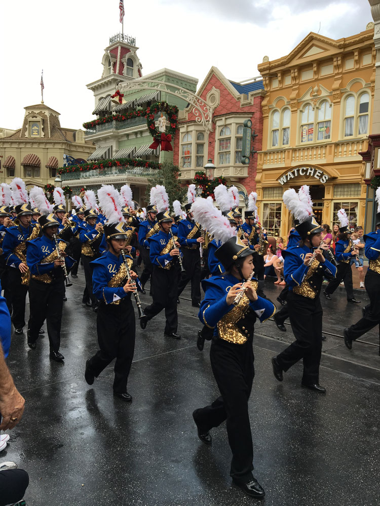 The Unionville High School Marching Band parades down Main Street USA at Disney World last week.